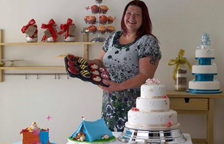 Sarah Harper holding cakes